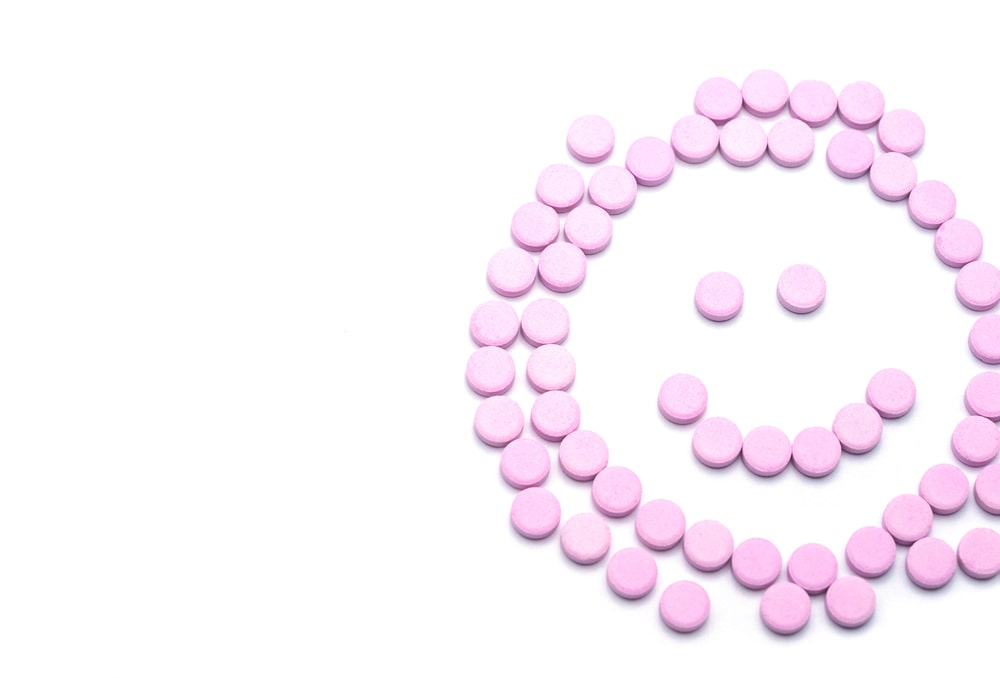 Birth control pills in the shape of a smiley face