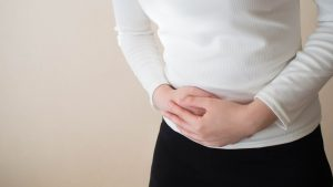 Lowering risk of ovarian Cysts - Holding stomach