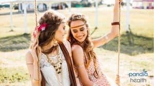 Two long hair brunette girls festival vibes