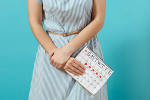 Myths About Periods: Women holding calendar